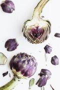 Artichokes and individual artichoke leaves (seen from above) Stock Photos