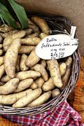 French 'La Ratte' potatoes in a basket of the market Stock Photos