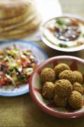 Falafel, salad, unleavened bread and hummus (North Africa) Stock Photos