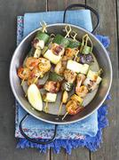 Salmon skewers with courgettes and prawns Stock Photos