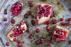 Sliced pomegranate on a silver tray Stock Photos