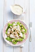 Caesar salad with avocado, chicken and croutons Stock Photos