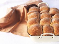 Buchteln (baked, sweet yeast dumplings) in a baking tin Stock Photos