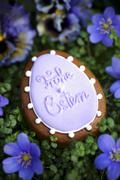 An egg-shaped candle with the words 'Frohe Ostern' surrounded by liverwort Stock Photos