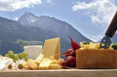 Zillertaler Heumilchkäse (cheese made from silage-free milk) – An arrangement of Stock Photos