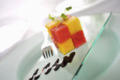 Diced melon with balsamic vinegar Stock Photos