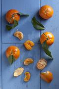 Clementines with leaves, whole and peeled Stock Photos