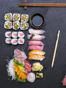 A platter of sushi featuring sashimi, ginger and wasabi Stock Photos