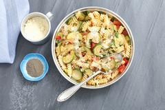 Fusilli bake with minced meat, courgette, tomatoes and Parmesan Stock Photos