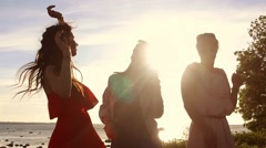 Group of happy women or girls dancing on beach 40 Stock Footage