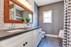 Elegant bathroom interior with tile floor and gray walls.  Northwest, USA Stock Photos