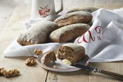 Malt bread rolls with walnuts and butter Stock Photos