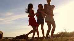 Group of happy women or girls dancing on beach 57 Stock Footage