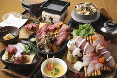 A party platter of beef, soup and sashimi (Japan) Stock Photos