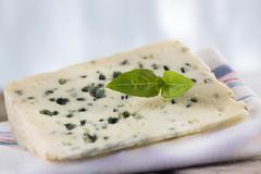 A slice of Roquefort Marival (French blue cheese) Stock Photos
