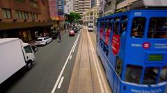 TRAFFIC TRAMS SHOPS WAN CHAI HONG KONG CHINA Stock Footage