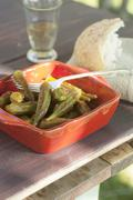 Greek style pickled okra with white bread and wine Stock Photos