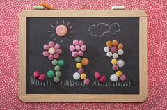 Bonbon flowers on a chalkboard Stock Photos