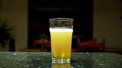 FIZZY PINT OF LAGER BEER SCARBOROUGH ENGLAND Stock Footage