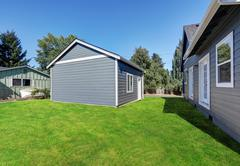 Blue clapboard siding house with matching detached garage, Northwest, USA Stock Photos
