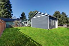 Grass filled back yard with Detached garage. Northwest, USA Stock Photos
