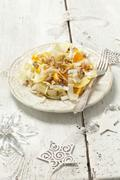 Chicory salad with oranges and walnuts Stock Photos