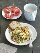 Scrambled eggs with mixed wild mushrooms Stock Photos