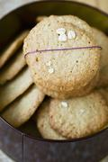 Oat biscuits in a biscuit tin Stock Photos