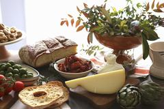 An Apulian arrangement of cheese, bread, pastries and vegetables Stock Photos