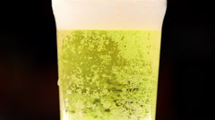 BUBBLES FIZZY PINT BEER LAGER SCARBOROUGH ENGLAND Stock Footage