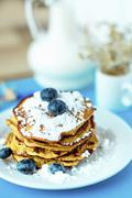Gluten-free corn pancakes with blueberries and icing sugar Stock Photos