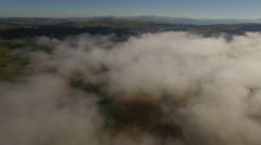 Aerial: camera pan to the right opening beautiful cloud scenery below. Stock Footage