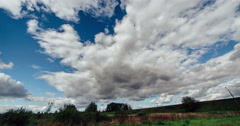 4K. Timelapse clouds over the green field. FULL HD, 4096x2160 Stock Footage