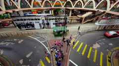 TRAMS BUSES PEDESTRIANS CAUSEWAY BAY HONG KONG Stock Footage
