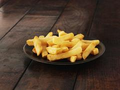 A plate of chips Stock Photos