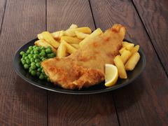 Fish and chips with peas and lemon Stock Photos