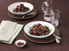 Provençal beef with olives and green beans Stock Photos