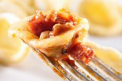 Orecchiette al ragù di carne e salame (pasta with a meat and sausage sauce, Stock Photos