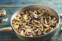 Penne con melanzane e menta (pasta with grilled aubergines and peppermint, Stock Photos