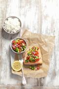 Baked salmon with avocado and tomato salsa and rice Stock Photos