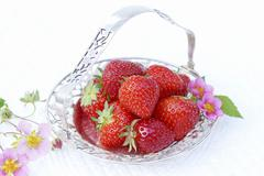 Strawberries and strawberry flowers in a silver dish Kuvituskuvat