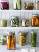 Preserved fruit and vegetables on shelves in a pantry Stock Photos