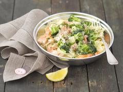 Tagliatelle with salmon, broccoli and cream sauce Stock Photos