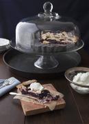 A half-eaten mulberry pie with cream Stock Photos