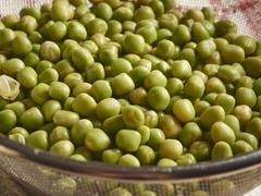 Soaked marrowfat peas in a sieve Stock Photos
