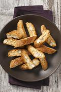 Biscotti in a brown bowl Stock Photos