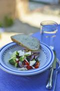Greek salad on table out of doors Stock Photos