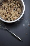 Chocolate chip cookie dough with pecan nuts in a mixing bowl Stock Photos