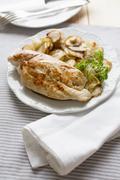 Chicken breast with Jerusalem artichokes Stock Photos