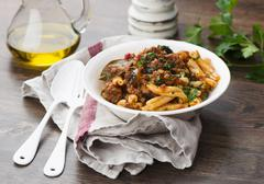 Pasta with a lamb and aubergine sauce and yoghurt Stock Photos
